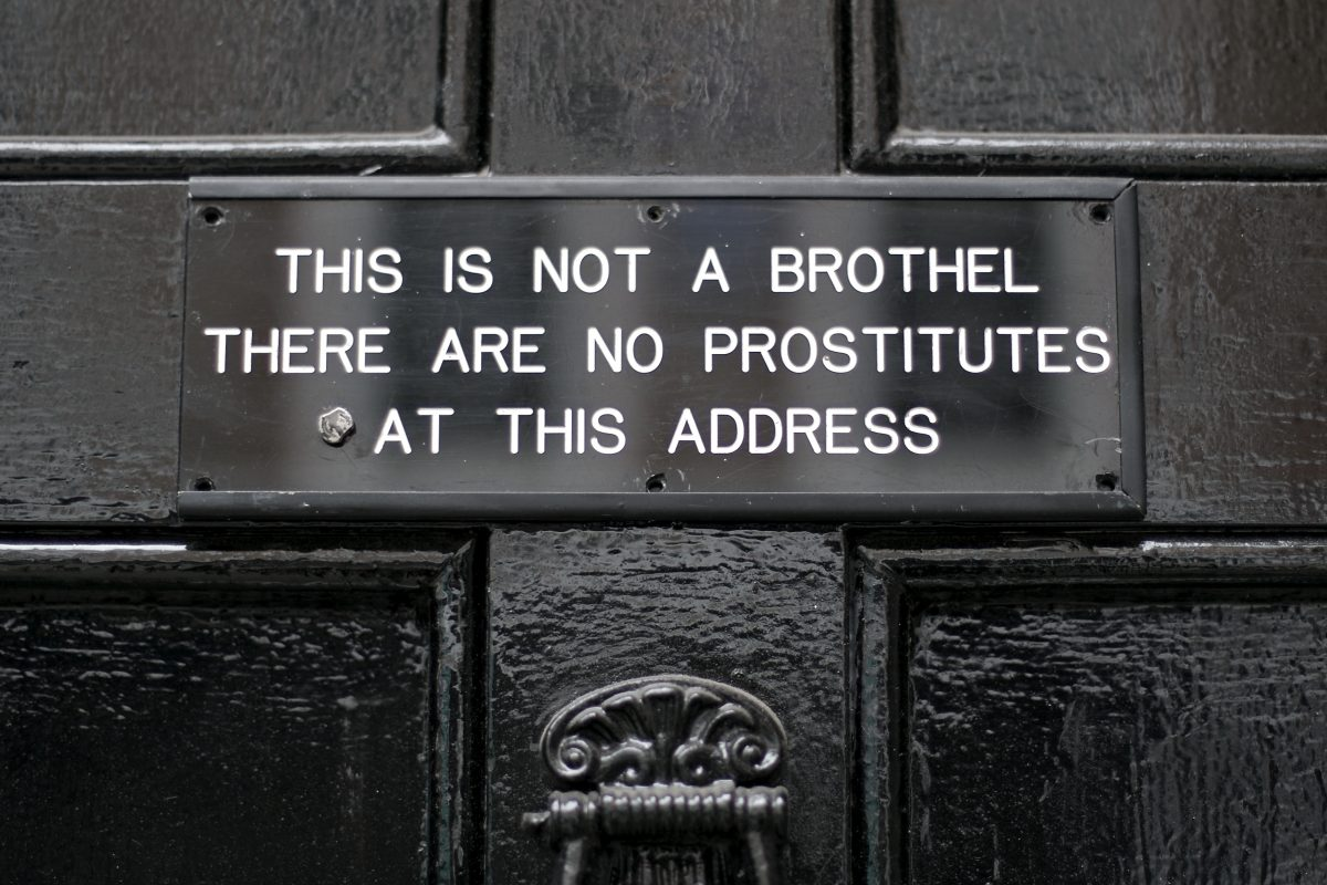 "Sign saying ""This is Not a Brothel. There Are No Prostitutes Here."" from a street in Soho, London"